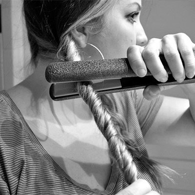 For fast curls, twist a section of your hair, then slide a hair straightener along it!